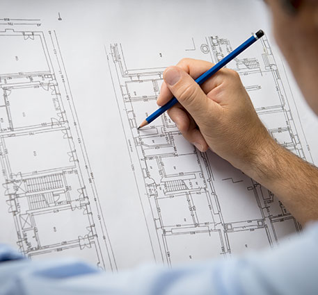 Man pointing the pencil to the floor plan.